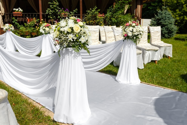 Wedding ceremony decorations. flowers and chairs close up