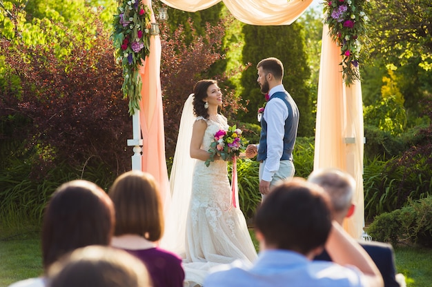 Wedding ceremony in the garden outdoors
