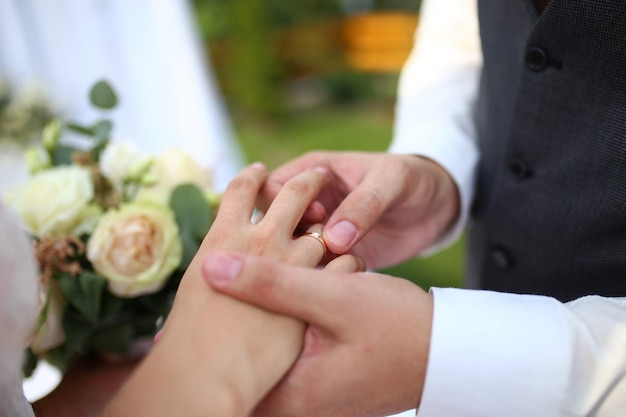 Wedding ceremony. groom puts the engagement ring on to the bride. wedding day