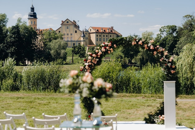 Wedding ceremony on the street on the green lawn near the nesvizh castle.belarus.