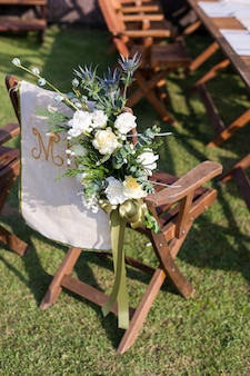 Wedding ceremony with flowers outside in the garden
