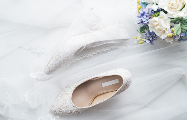 Wedding concept, bride shoes and flowers