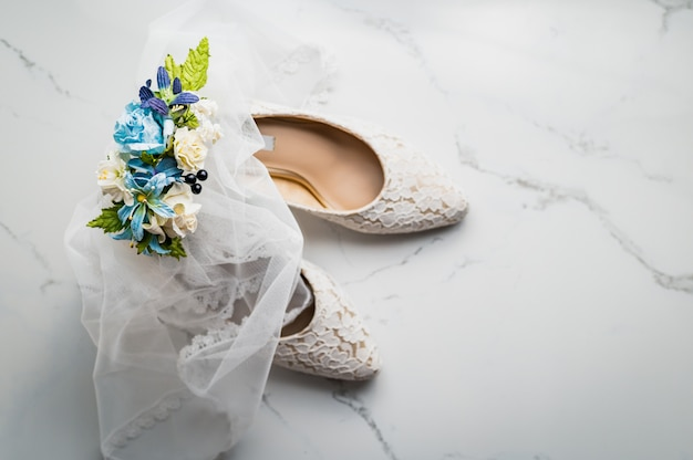 Wedding concept, bride shoes and rose, top view