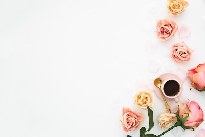 Wedding concept made with pink roses, and cup of coffee with copy space