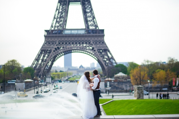 Wedding couple. the bride in a beautiful wedding dress, the bride in a stylish tuxedo, paris france