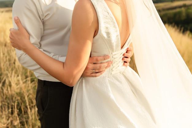 Wedding couple, bride and groom holding hands, beautiful wedding day