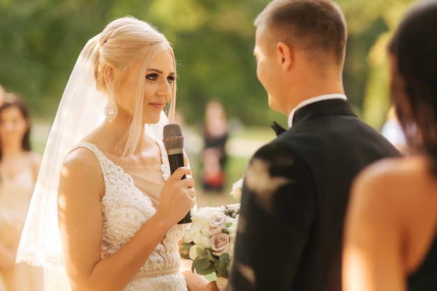 Wedding couple on ceremony outside beautiful bride and handsome groom just married
