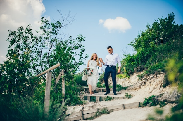 Wedding couple in a forest in the mountains