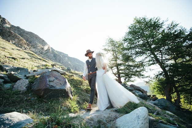 Wedding couple getting married in the mountains in switzerland