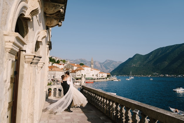 Wedding couple on the hotel terrace with panoramic views. montenegro
