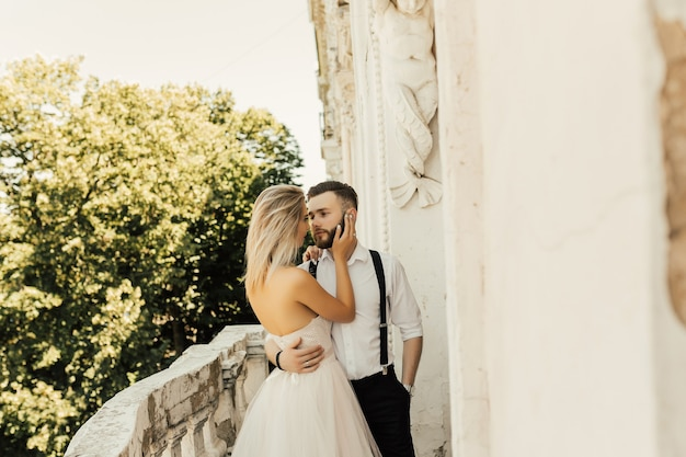 Wedding couple in the hotel with beautiful architecture