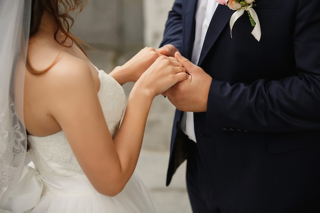 Wedding couple in love. bride and groom holding hands with engagement ring