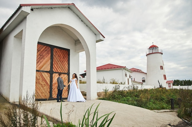 Wedding of a couple in love in nature at the lighthouse. hugs and kisses of the bride and groom