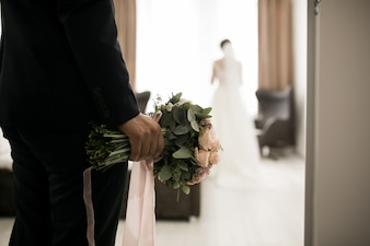 Wedding couple meeting together in room