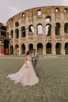 Wedding couple near  colosseum in rome, italy