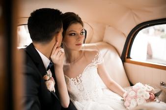 Wedding couple photo shoot by retro car