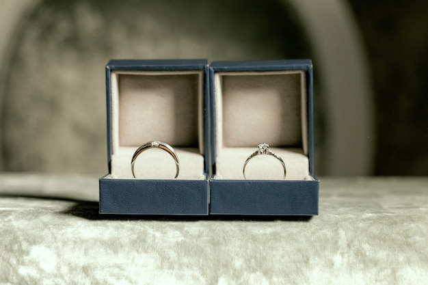 Wedding couple rings placed in boxes