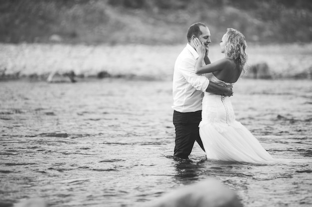 Wedding couple on the river