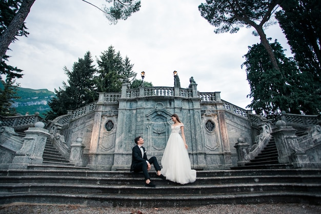 Wedding couple on the stairs in the park