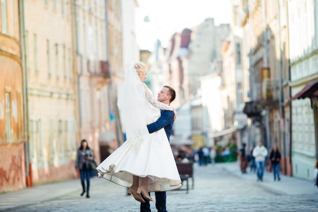 Wedding couple walking on streets of city
