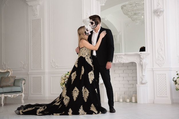 A wedding couple with skeleton make up for halloween or all souls day