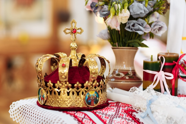 Wedding crowns. wedding crown in church ready for marriage ceremony. close up. divine liturgy.