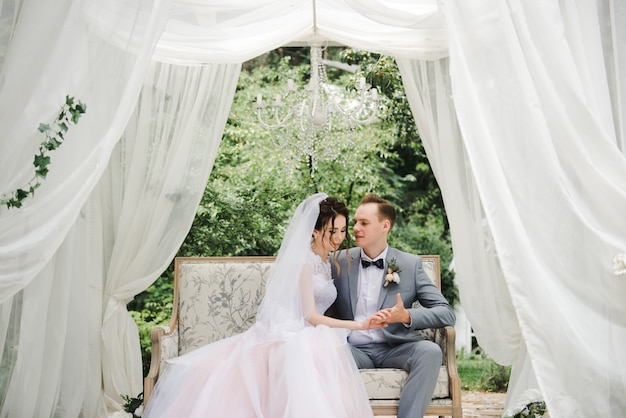 Wedding day. the bride in a pink dress, the groom in a gray suit.