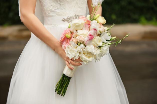Wedding day. bride with wedding bouquet