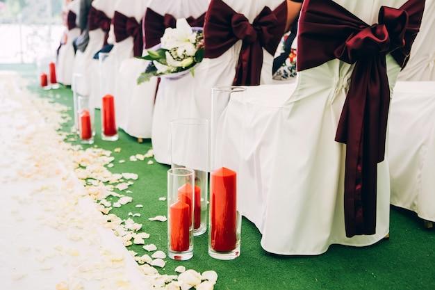 Wedding decor, candles in glass flasks.