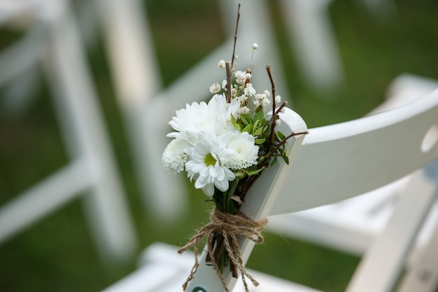 Wedding decor on chair for guests at wedding ceremony
