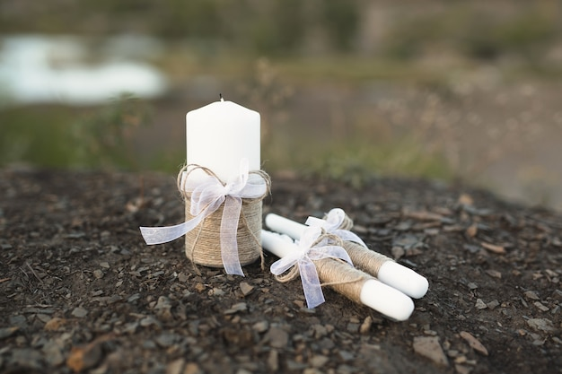 Wedding decor in rustic style . wedding candles for the family hearth, burlap decor