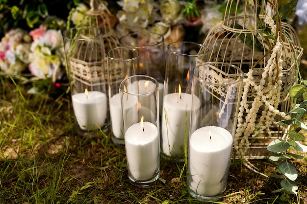 Wedding decor. solemn ceremony. wedding in nature. candles in decorated jars. just married.
