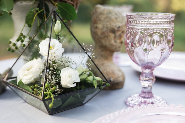 Wedding decor of a table, florarium with roses