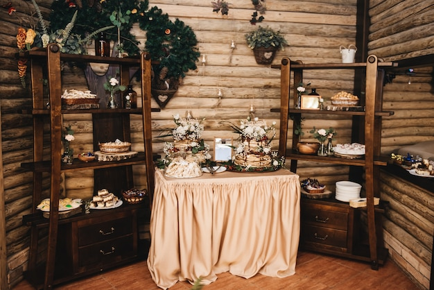 Wedding decor. wedding interior. festive decor. table decor. table with sweets and treats for guests.