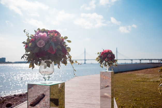 Wedding decor. wedding registration outdoor. luxury bouquets with red flowers