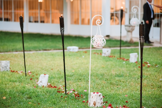 Wedding decoration of black and white lit torches