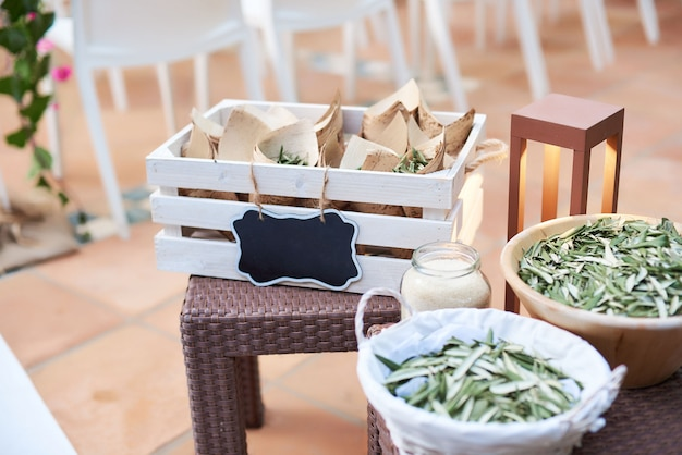Wedding decoration details with dried olive tree leaves