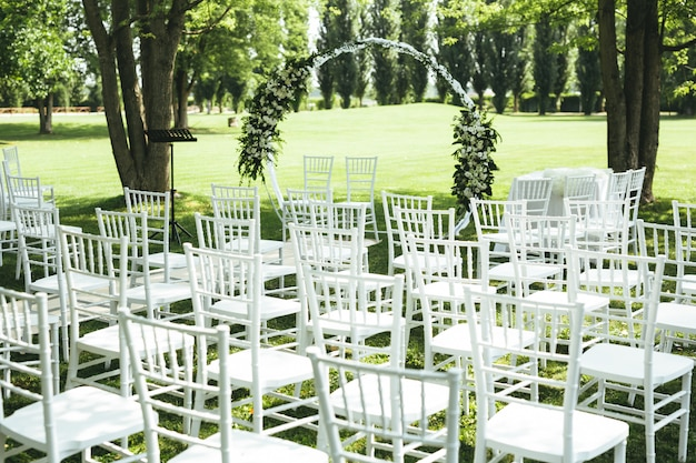 Wedding decoration with white chairs and white flowers