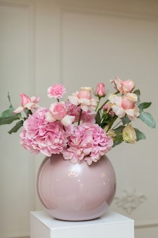 Wedding decorations, holiday decoration vase with fresh flowers, pink roses and carnations,