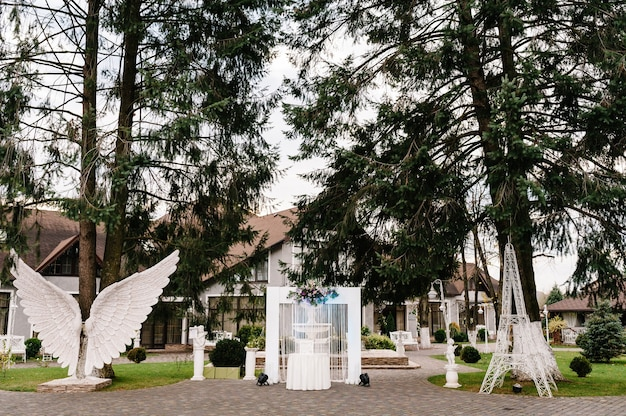 Wedding decorations in luxury ceremony. arch for ceremony a is decorated with flowers and greens, greenery.