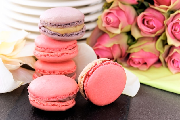 Wedding dessert with macaroons, coffee and strawberry