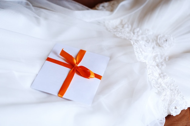 Wedding details invitation on dress