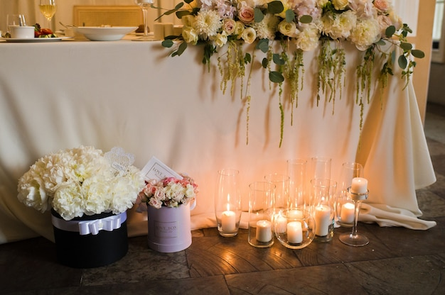Wedding dinner in the restaurant decorated with candles.