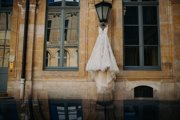 Wedding dress hanging on the street lamp