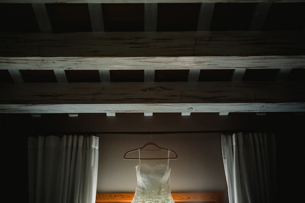 Wedding dress hanging on top of the roof.