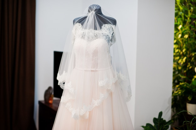 Wedding dress in the middle of the room isolated.