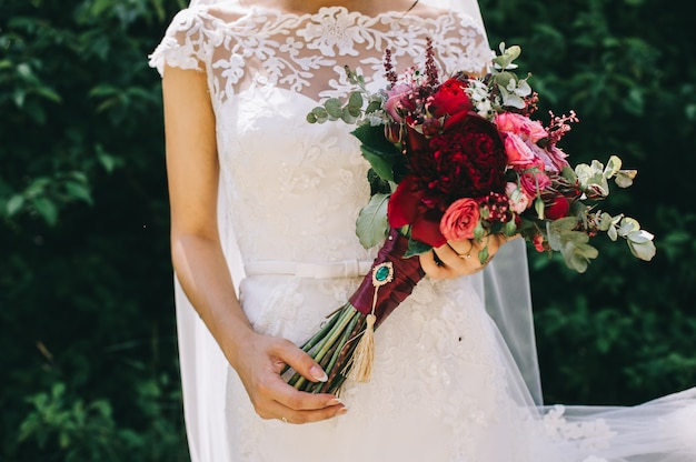 Wedding dress, wedding rings, wedding bouquet
