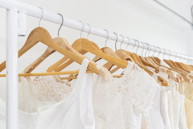 Wedding dresses on a hanger.