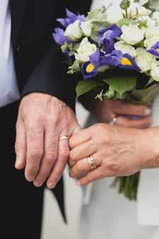 Wedding of the elderly, the bride holds a beautiful bouquet.