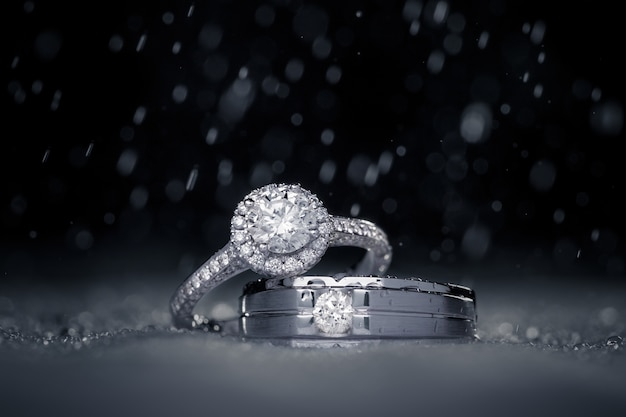 Wedding engagement diamond rings with water drops